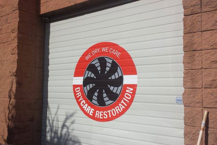 DryCare Restoration logo on garage door | Best Water Fire Mold Damage Restoration and Crime Scene Cleanup, Los Angeles Ventura Orange County