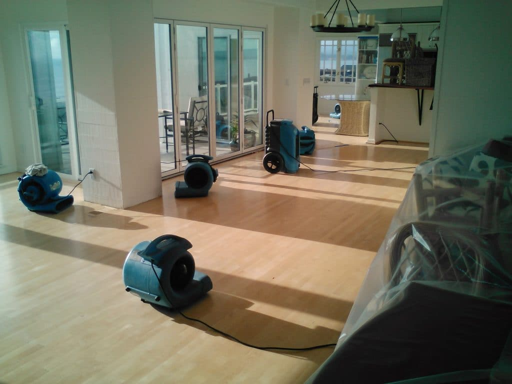 water damage restoration with professional blow dryers inside an apartment | DryCare Restoration Team | Best Water Fire Mold Damage Restoration and Crime Scene Cleanup in Southern California